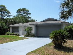 JUST LISTED!!  Port Charlotte Pool Home Under $200K!